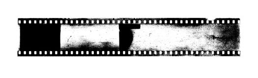 Strip of old camera film with dust and scratches. On white background Stock Image