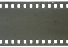 Strip of old celluloid film with dust and scratches. Strip of old celluloid film on white background Royalty Free Stock Images