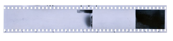 Strip of old celluloid film with dust and scratches Royalty Free Stock Photo