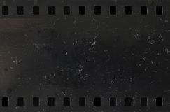 Strip of old celluloid film with dust and scratches Royalty Free Stock Image