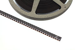 Strip of old movie film next to reel Royalty Free Stock Photos