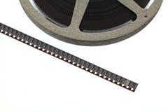 Strip of old movie film next to reel Royalty Free Stock Photos