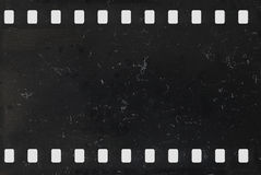 Strip of old negative celluloid film with dust and scratches. Strip of old celluloid film with dust and scratches - negative Stock Photos