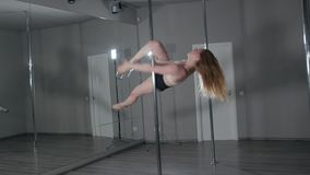 Strip plastic pole, dance floor training with professinal sport acrobatics stock footage