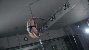 Strip plastic pole, dance floor training with professinal sport acrobatics stock video footage