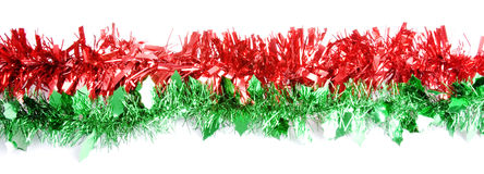 Strip of Red and Green Tinsel. Ideal for any Xmas article Royalty Free Stock Photo