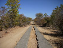Strip road in Africa. Old fashion tar strip road in Zambia and Zimbabwe Royalty Free Stock Images