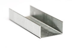 Strip of staples on its back isolated Stock Photo