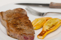 Strip Steak and Grilled Squash on a White Plate Stock Photos