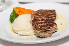 Strip Steak with Mashed Potatoes Royalty Free Stock Photos