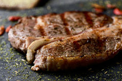 Strip steak seasoned with different spice Stock Image