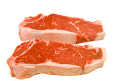 Strip Steaks on White Royalty Free Stock Photos