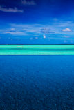 Strip of tropical ocean between pool and sky royalty free stock images