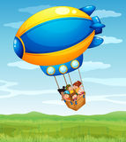 A stripe airship carrying a group of kids Royalty Free Stock Image