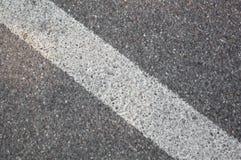 Stripe on the asphalt Stock Photography