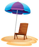 A stripe beach umbrella and a wooden chair Royalty Free Stock Images