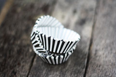 Stripe black and white muffin or cupcake cups. Royalty Free Stock Photography