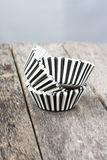 Stripe black and white muffin or cupcake cups. Stock Photos