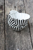 Stripe black and white muffin or cupcake cups. Royalty Free Stock Photo