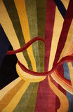 Stripe Carpet. Colorful stripe in the image of wrapped up drapes used in a carpet stock photo