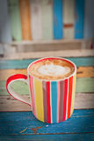 Stripe coffee cup on retro background Stock Photos