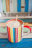 Stripe coffee cup on retro background Stock Images