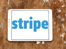 Stripe company logo. Logo of Stripe company on samsung tablet on wooden background. Stripe is a US technology company operating in over 25 countries, that allows royalty free stock image