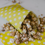 Stripe and Dots Package of Chocolate Popcorn Movie Concept Stock Photos