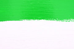 Stripe of green paint over white wooden background Royalty Free Stock Photos