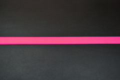 Stripe in a middle. Pink line at bottom. Pink color of belt. Belt from leather Stock Image