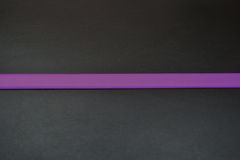 Stripe in a middle. Purple line at bottom.Purple color of belt.Belt from leather Royalty Free Stock Photo
