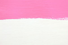 Stripe of pink paint over white wooden background Royalty Free Stock Photography