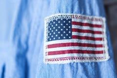 Stripe of USA flag on shirt sleeve Royalty Free Stock Photos