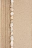 Stripe of white stones lying on the sand Royalty Free Stock Photos