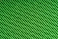 Striped бумага выбитая зеленым цветом покрашенная бумага Зелёная предпосылка текстуры Стоковое Фото