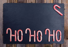 Striped праздником текст тросточки конфеты Ho-Ho-Ho Стоковая Фотография
