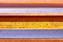Rusted metal background with irregular stripes stock images