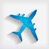 Striped airplane on a grey background Stock Photos