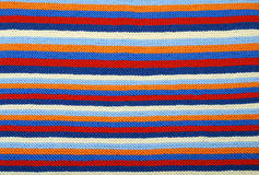 Striped background of knitted cloth. Stock Photo
