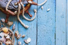 Striped bag, wheel and maritime decorations on the wooden background Stock Photo