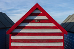 Striped beach hut on summer day in Kent, England. Cute beach hut in Kent, England Royalty Free Stock Images
