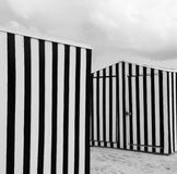 Striped beach shed on sand Royalty Free Stock Photography