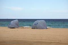 Striped beach shelters on Dania Beach Royalty Free Stock Photo