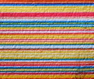 Striped beach towel useful as a background pattern stock photo