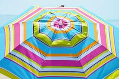 Striped beach umbrella. Royalty Free Stock Photos