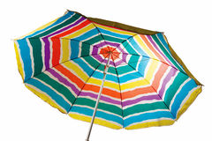Striped beach umbrella. Isolated beach umbrella with red, yellow, blue and green stripes Stock Image