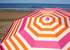 Striped beach umbrella Royalty Free Stock Images