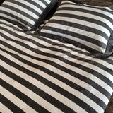 Striped bed linen Stock Photography