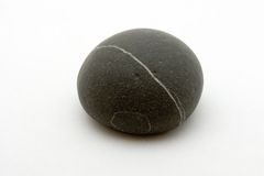Striped black rock. On white background Royalty Free Stock Image