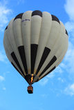 Striped black and white hot air balloon stock image